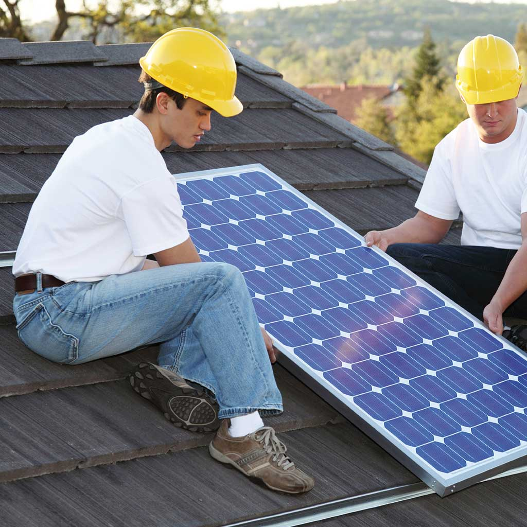 two men inserting a solar panel