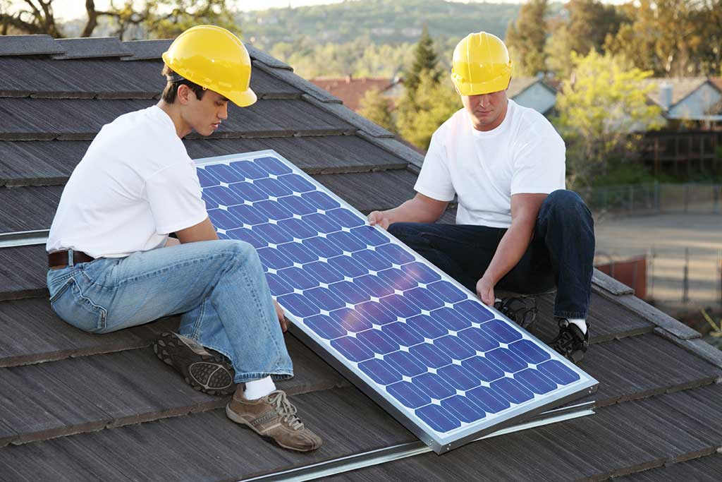 two men installing a solar panel
