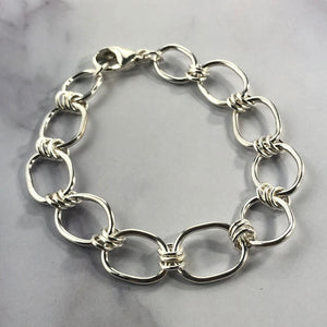 silver link bracelet on marble background