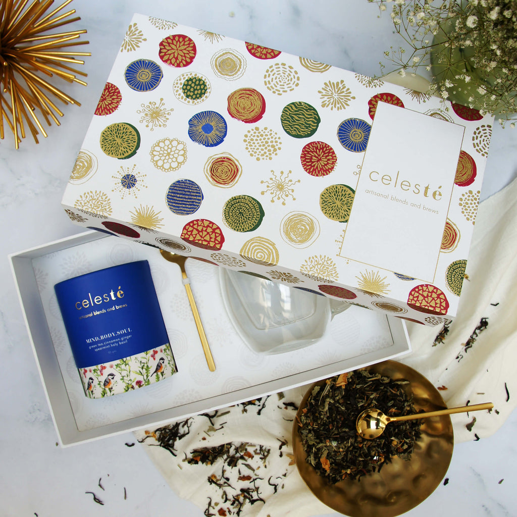 top view of celeste floral and herbal tea gift box with CLEAR BREWING CUP and DECADENT SPOON