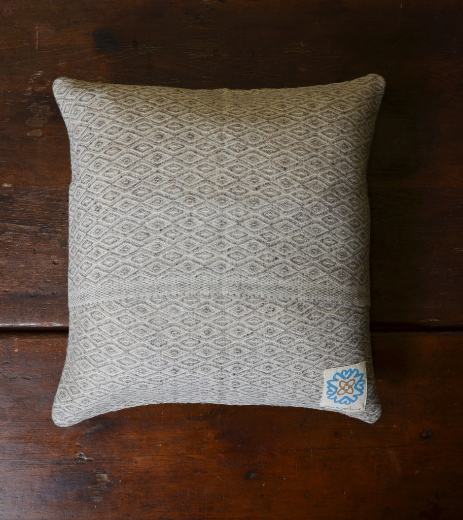 Ojo De Dios' Virgin Wool Pillow by Mexchic.  100% virgin, all natural, unprocessed Mexican wool. #Handcrafted #FairTrade #Sustainable #ThreeHeartsHome
