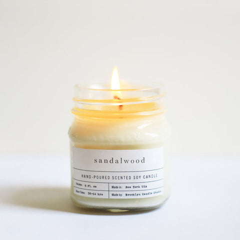 """Sandalwood"" hand poured mason jar candle by Brooklyn Candle Studio.  100% Soy Wax. Small Batch, Handmade in US."