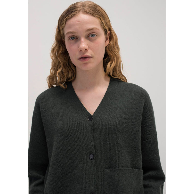model wearing dark green knit cardigan buttoned up
