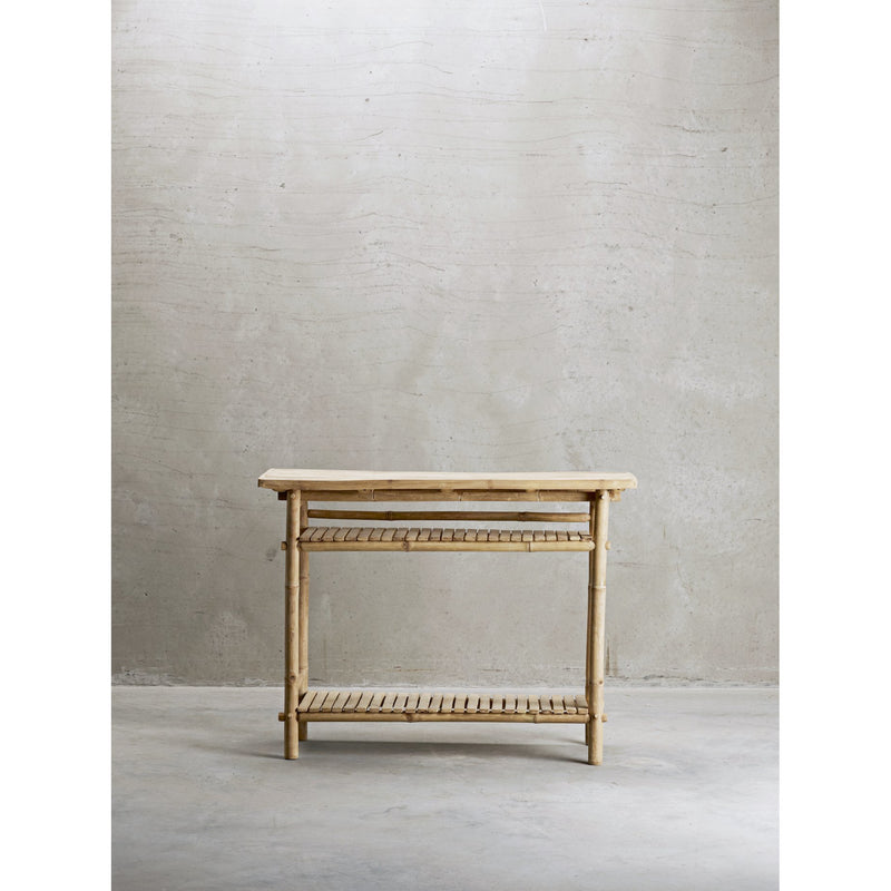 bamboo console table with two shelves against a grey wall