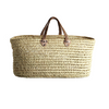 large woven palm leaf shopper bag with two natural toned leather handles