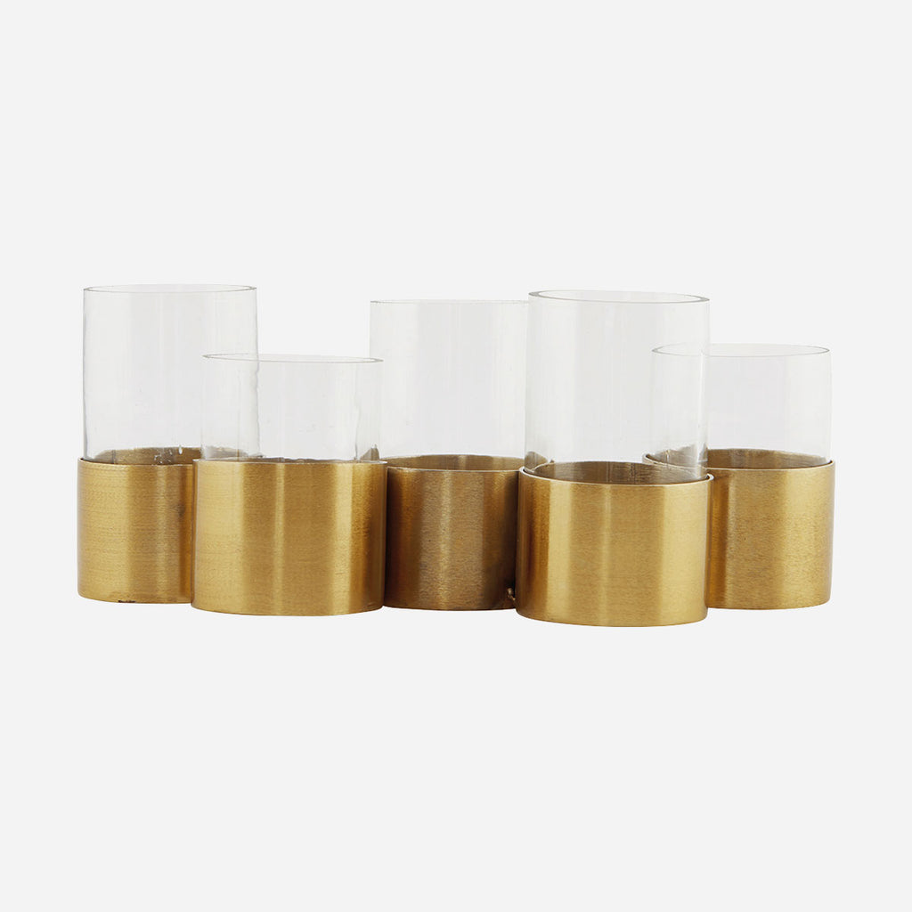 line of brass ringed holders with cylindrical glass vases in each by house doctor