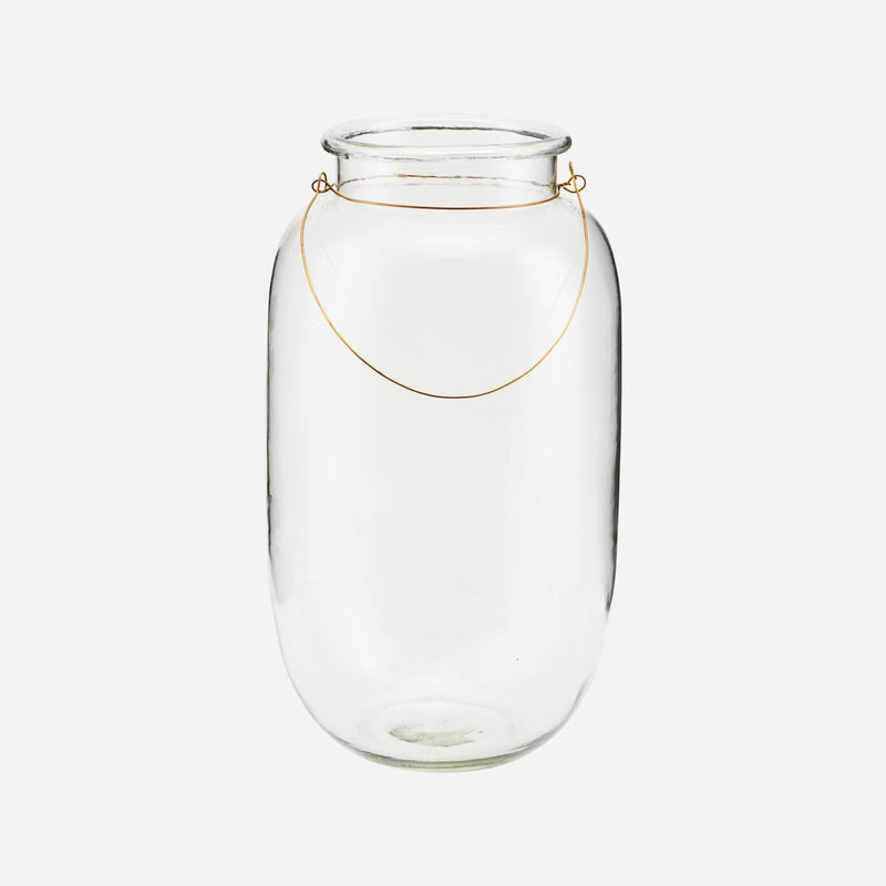 large glass jar with a thin brass handle