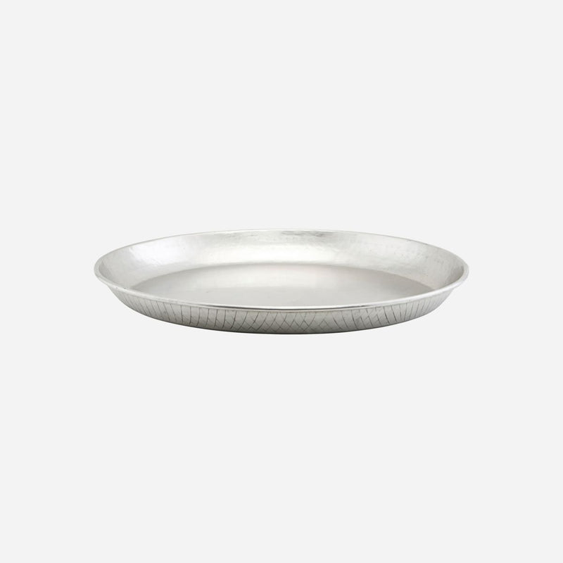 shallow rounded silver tray by house doctor