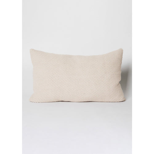 cream colored rectangular knitted pillow by designer aiayu