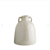 white ceramic jug with two tab handles at the neck