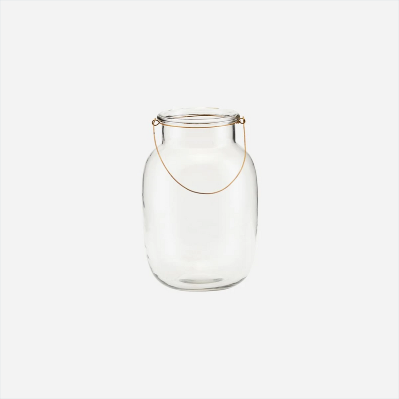 small glass jar with a thin brass handle