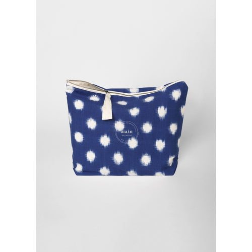 organic cotton pouch in navy with white ikat pattern details and a ribbon zipper by designer aiayu