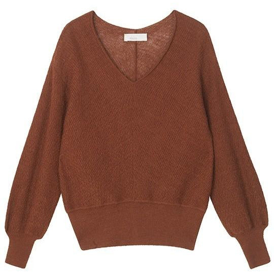 rust toned sweater with cinched hem lines by designer aiayu