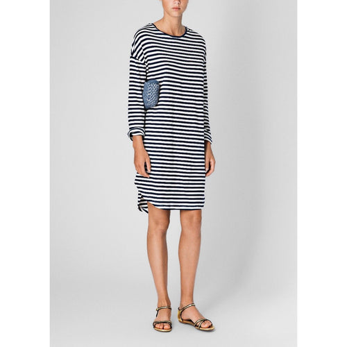 woman wearing black and white horizontal striped, 3/4 sleeve t-shirt dress