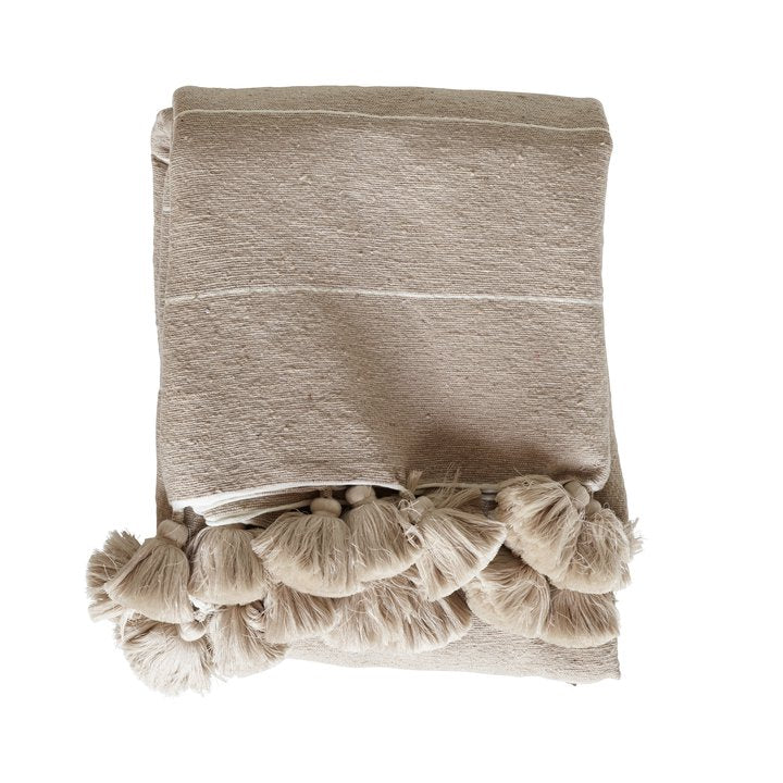 camel colored blanket with cream color tassels by designer tine k