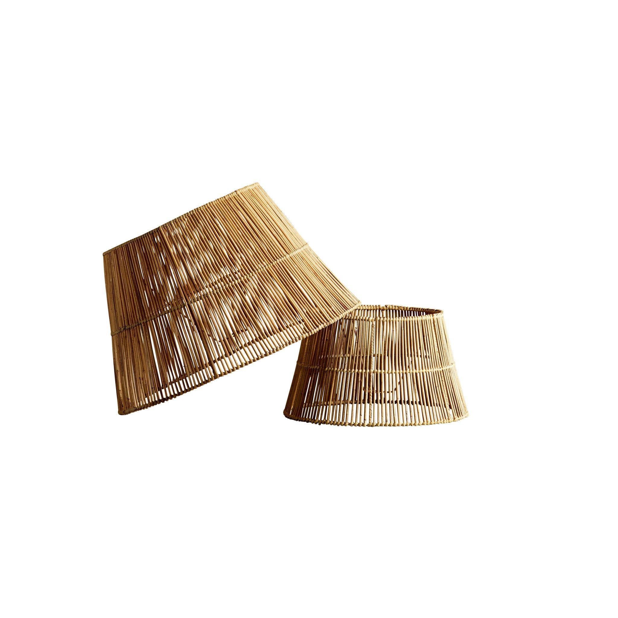 extra large rattan lampshade leaning against medium rattan lampshade