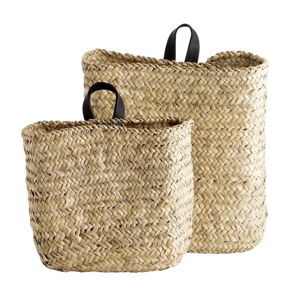 large and small woven baskets with black leather strap to hang