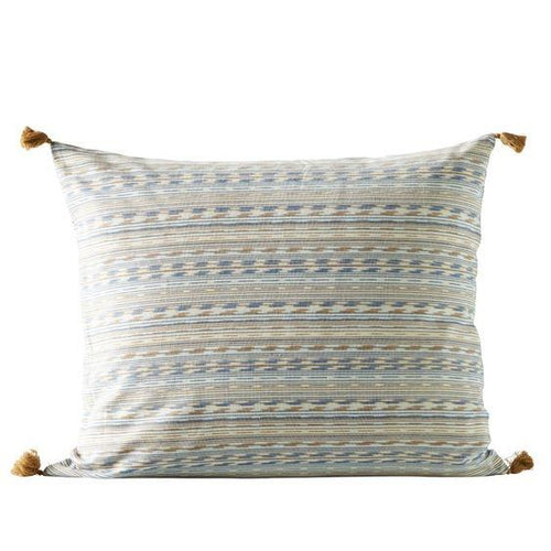 blue patterned pillow with tan tassels by designer tine k