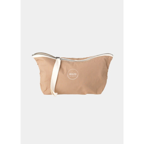 light pink mini pouch with white ribbon zipper by designer aiayu