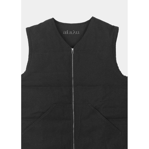 faded black corduroy vest with zipper detail and front pockets by designer aiayu