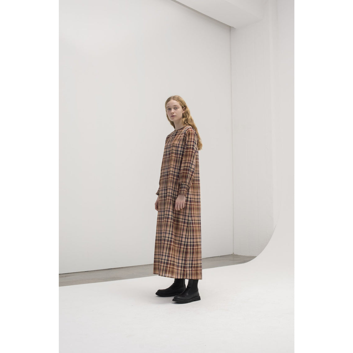 model wearing long sleeve mahogany toned plaid dress