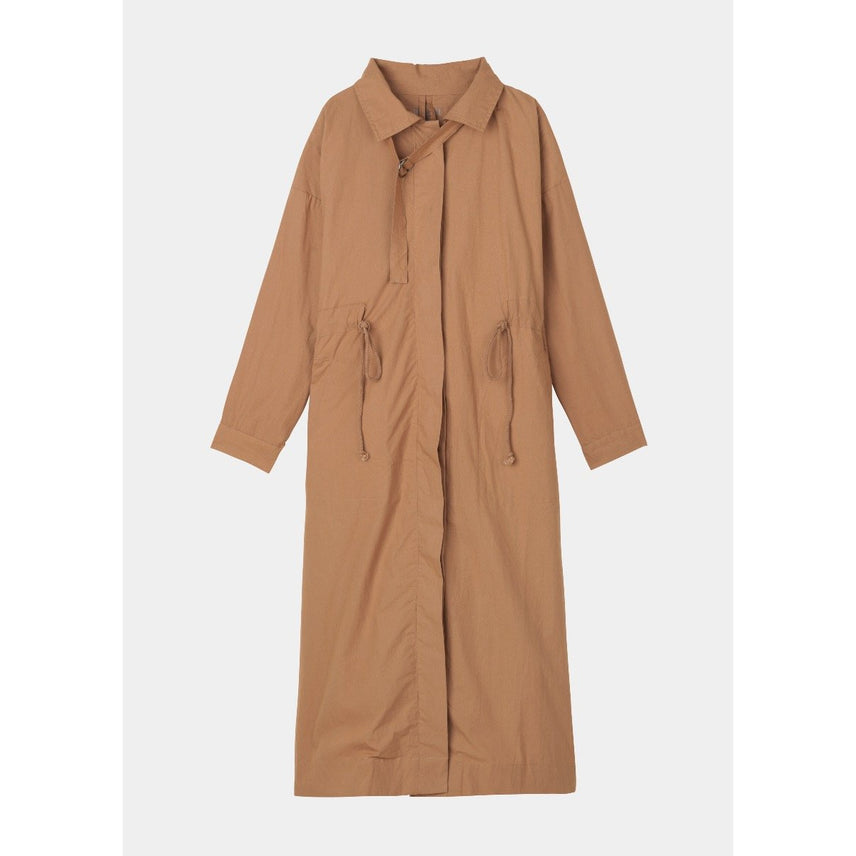 brown organic cotton ankle length coat with horn buttons, pockets, a drawstring waist and high slit in the back by designer aiayu