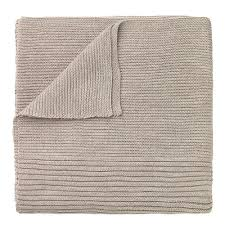 folded light tan cashmere blanket by designer aiayu