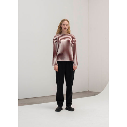 woman wearing bordeaux and white striped dropped shoulder long sleeve tee and black pants