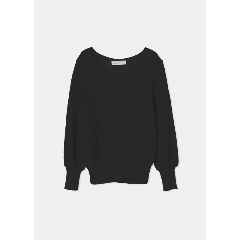 black knitted sweater with cinched hem lines at the sleeve and bottom by designer aiayu