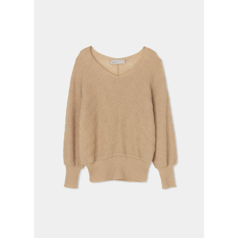 beige knitted sweater with cinched hem lines at the sleeve and bottom by designer aiayu