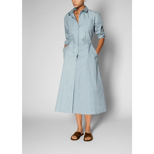 long sleeve button up dress in light blue worn with black sandals