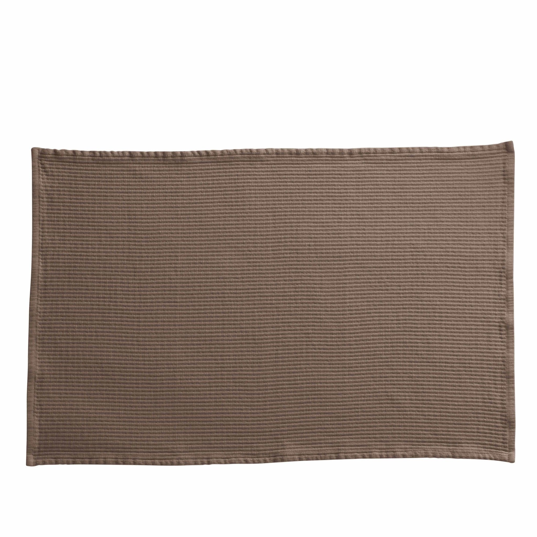 rectangular bath mat in a camel color by designer tine k