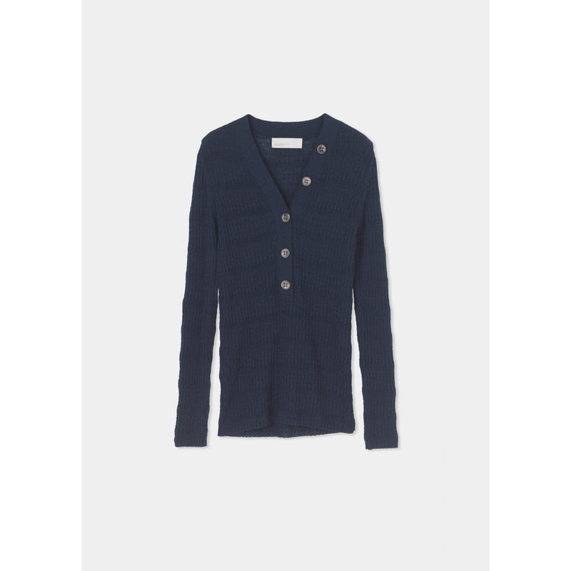 navy knitted long sleeve top with three buttons up the front, and two off the side up the neckline of the v-cut by designer aiayu
