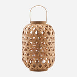 latticed bamboo lantern in oval shape by house doctor