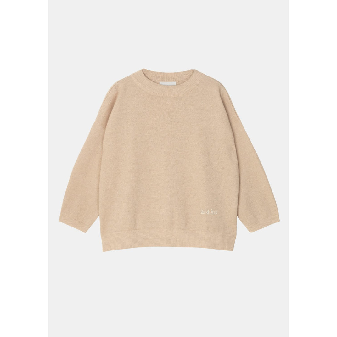 "light pink colored sweater with ribbed hem lines and ""aiayu"" stitched into the lower left hand corner by designer aiayu"