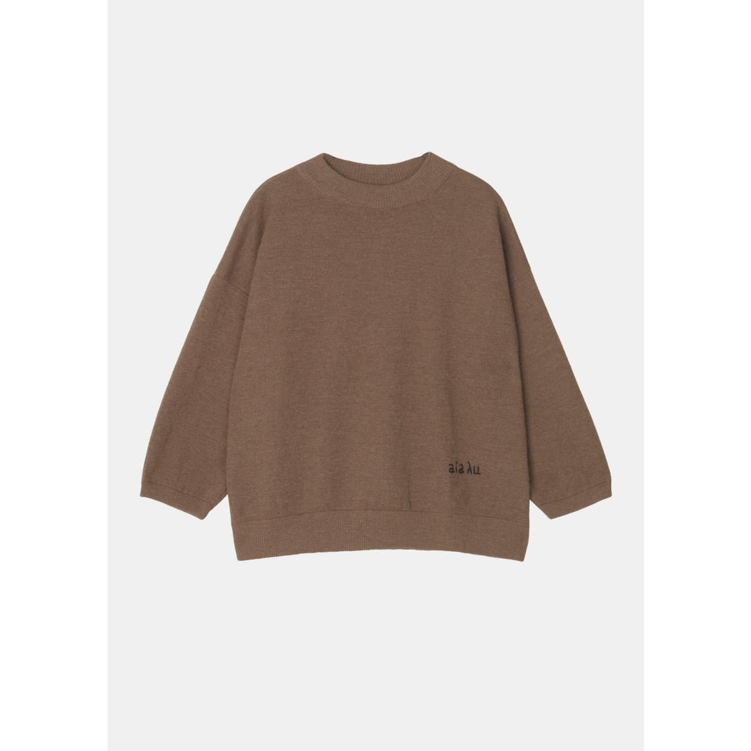 "tobacco colored sweater with ribbed hem lines and ""aiayu"" stitched into the lower left hand corner by designer aiayu"
