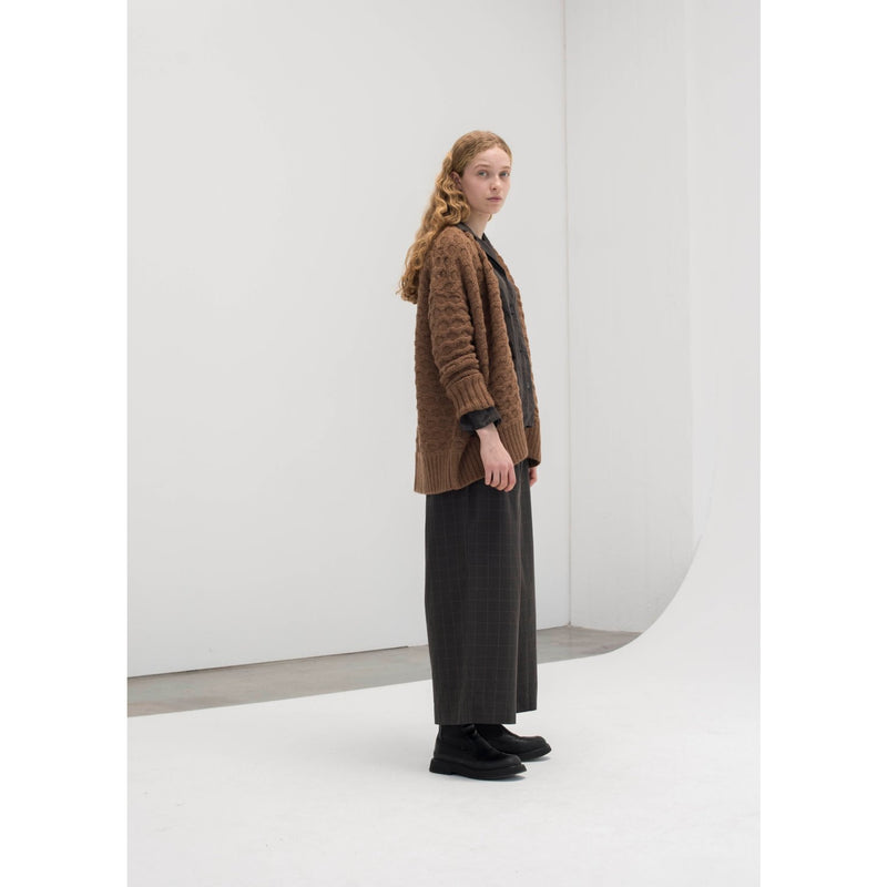 tobacco colored rib-bordered cardigan paired with a dark grey t-shirt and pants