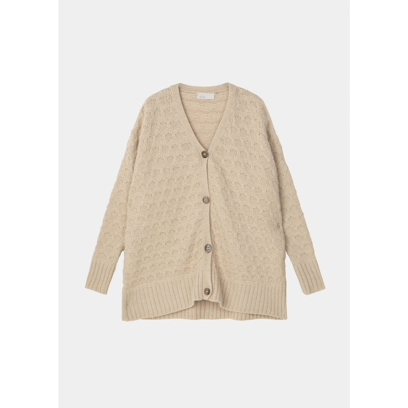 light pink colored rib-bordered knit cardigan with large horn buttons by designer aiayu
