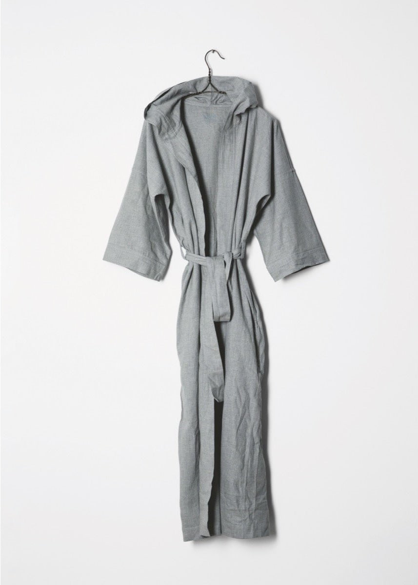 grey hooded bathrobe hung on a hanger