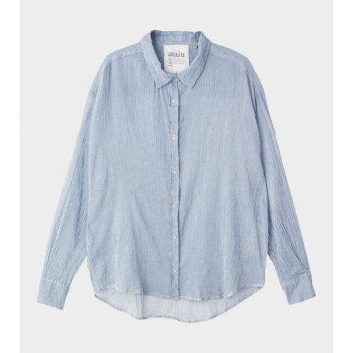blue organic cotton button up with a wrinkled look and curved hemline by designer aiayu