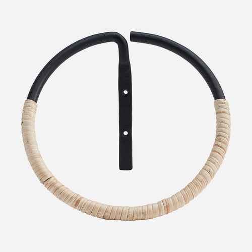 stainless steel towel ring half-wrapped in rattan by house doctor