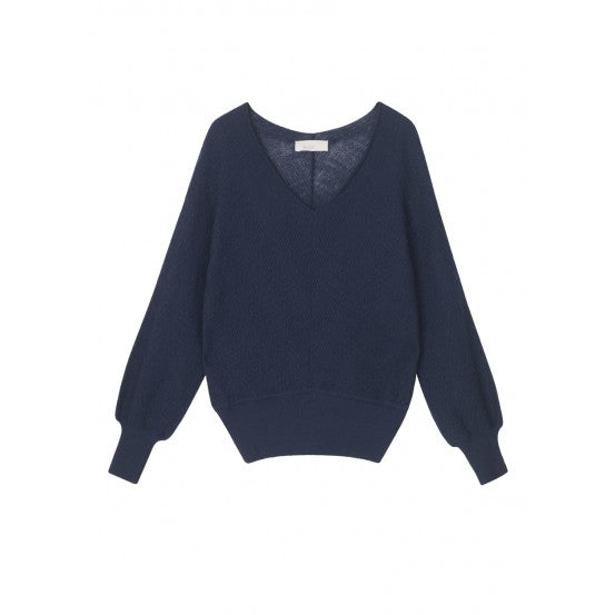 navy sweater with cinched hem lines by designer aiayu