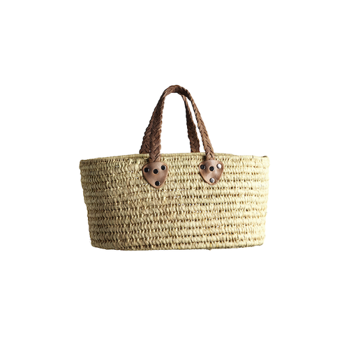 small woven palm leaf shopper bag with two natural toned leather handles
