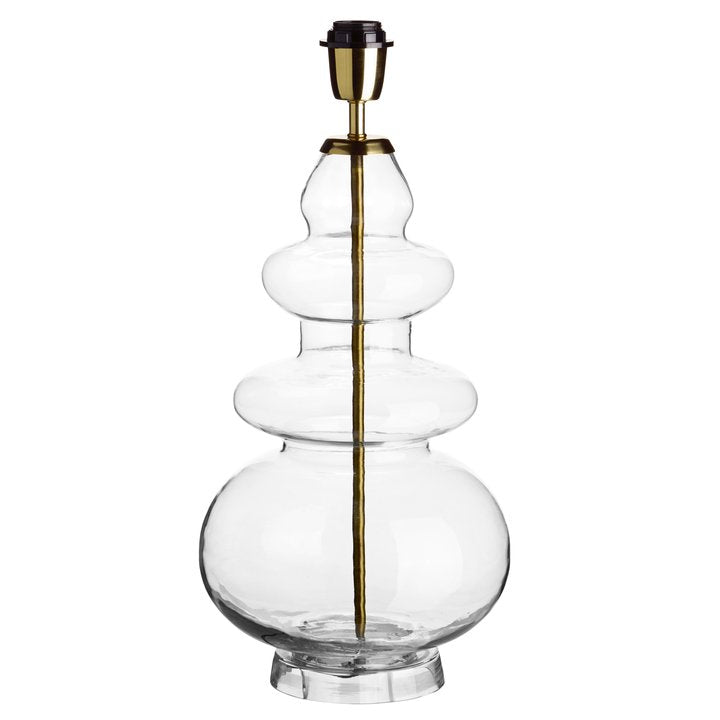 glass lamp with curved bulges and a brass top by designer tine k