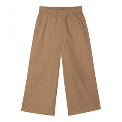 wide organic cotton pants in light brown with elastic waistband by designer aiayu