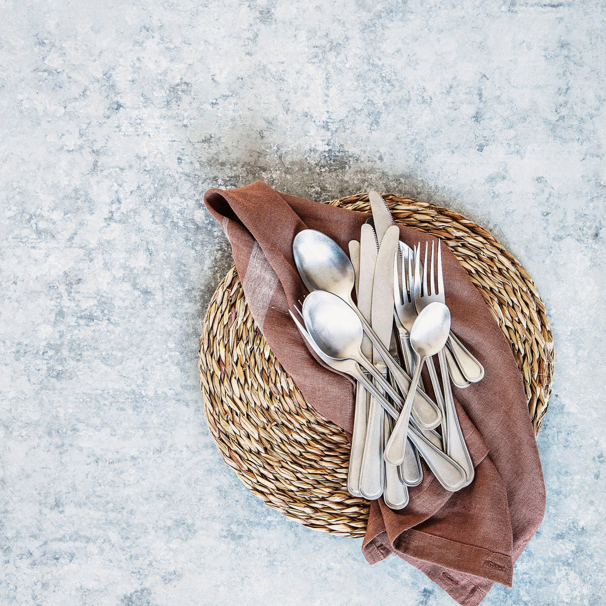 seagrass placemat under napkin with silverware