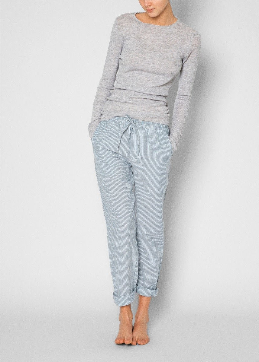 model wearing blue and white striped pants with a grey long sleeve