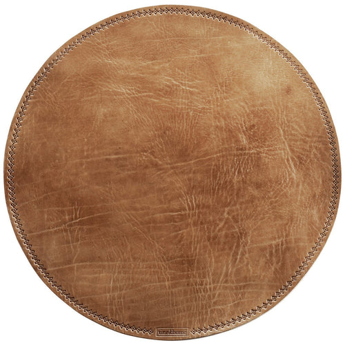 circular leather placemat in brown color by designer tine k