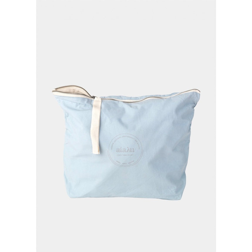 light blue organic cotton pouch with white ribbon zip closure by designer aiayu
