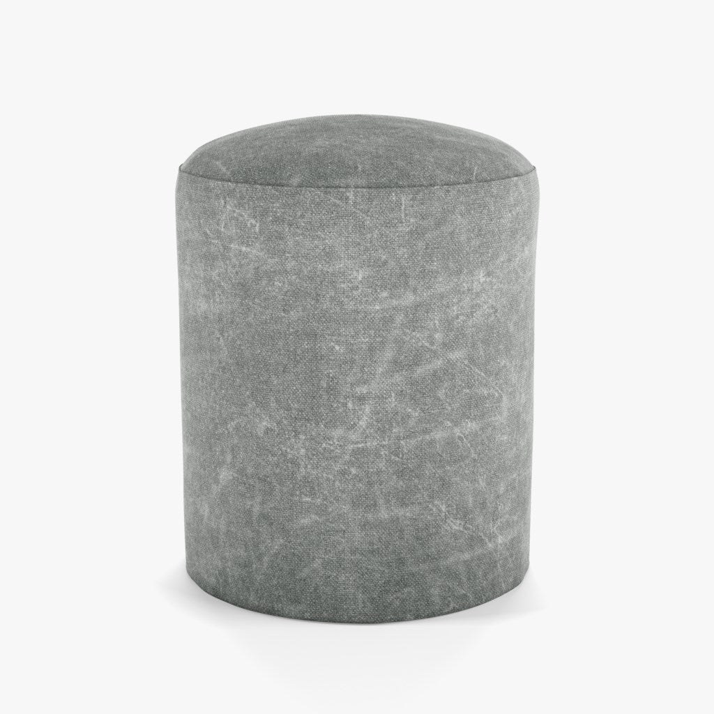 light grey colored linen cylindrical pouf or footrest by designer tine k